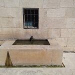 Small, stone, container, full of water at the Lavadora del Pilar.